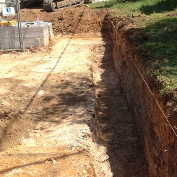 Retaining wall footing